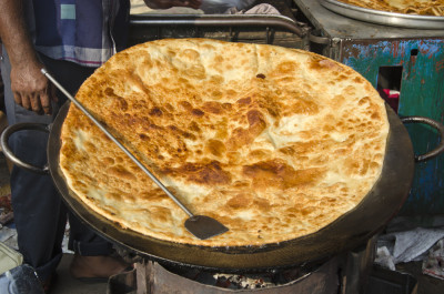 big pancake chapati bread in Mumbai Bombay market, India