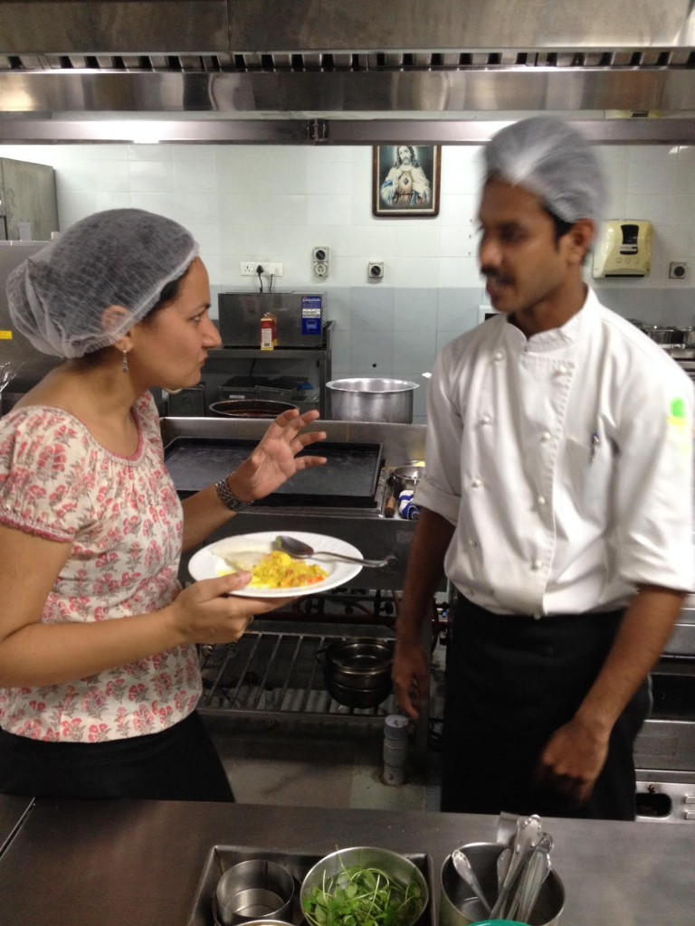 Ekta Kapur (Our Operations in India) discussing flavours with the Chef in a cooking class